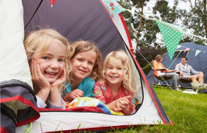 Smiling children in a tent